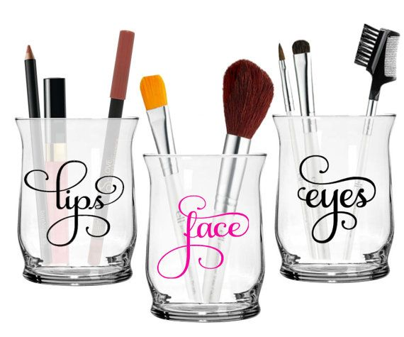 Set of 3 super cute makeup brush holders, one for lip pencils / glosses, one for eye brushes & pencils and one for face brushes. These makeup brush holders are perfect for storing or displaying your beautiful brushes, and make an excellent accent piece to your bathroom or vanity! Theyre decorative and functional! These cosmetic brush holders make great gifts! You may choose the colors for both of the words, you may also choose to have them etched at no additional charge. each holder is 4…