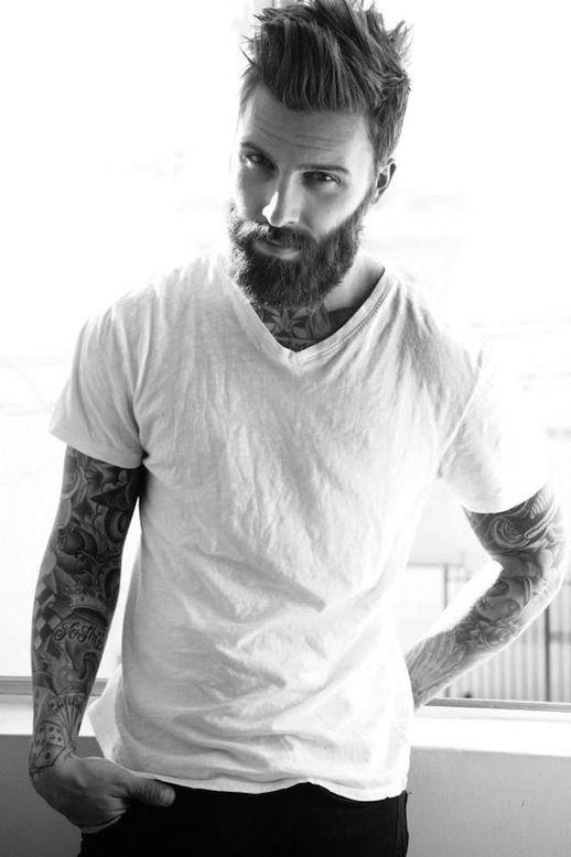 tattooed man with a beard. Love his hair too.