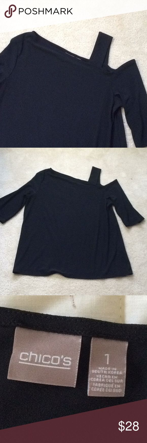 """Asymmetrical Top A new take on the cold shoulder.  Bra friendly strap.  Bust 20"""", length about 25"""".  Excellent condition.  Polyester and spandex mean comfort and no wrinkles.   Chico's size 1. Chico's Tops"""