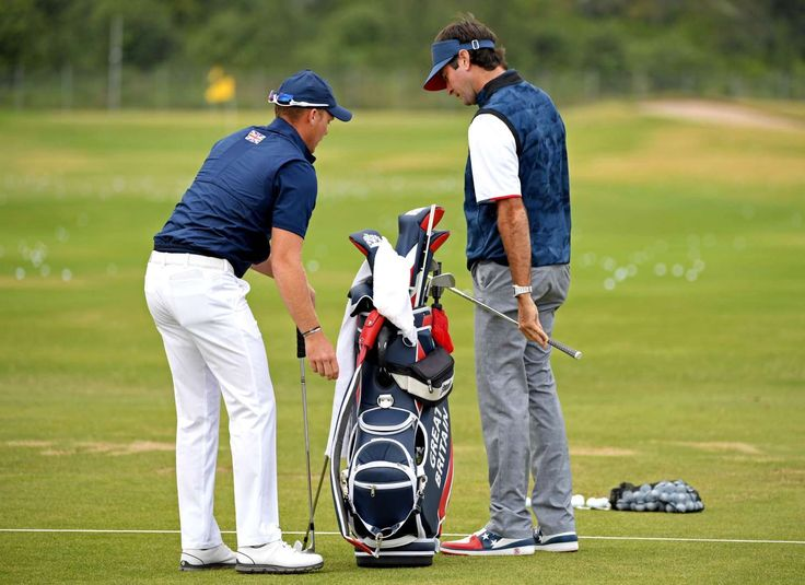 Danny Willett of Great Britain, left, talks with Bubba Watson of the United States on the prior to the first round of the men's golf in the Rio 2016 Summer Olympic Games at Olympic Golf Course.    -  Best images from Aug. 11 at the Rio Olympics