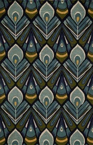 Tapis Momeni décoré de plumes de paon stylisées.