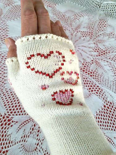 In 2008, we released our free Sweetheart Glovelets pattern. To celebrate our 10th anniversary, we have reimagined the original pattern -- and it's still free! Beads create a whimsical heart design, and bring color, sparkle, and fun to your knitting.