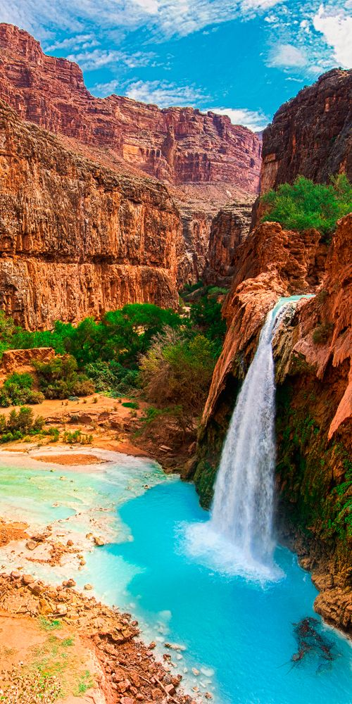 The beautiful turquoise waters of Havasu Falls from the minerals leaching from the limestone caverns