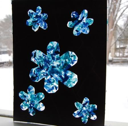 snow flake sun catcherCrafts Ideas, Kids Christmas Crafts, Winter Crafts, Contact Paper, Snowflakes, Kids Crafts, Windows Display, Holiday Crafts, Stained Glass