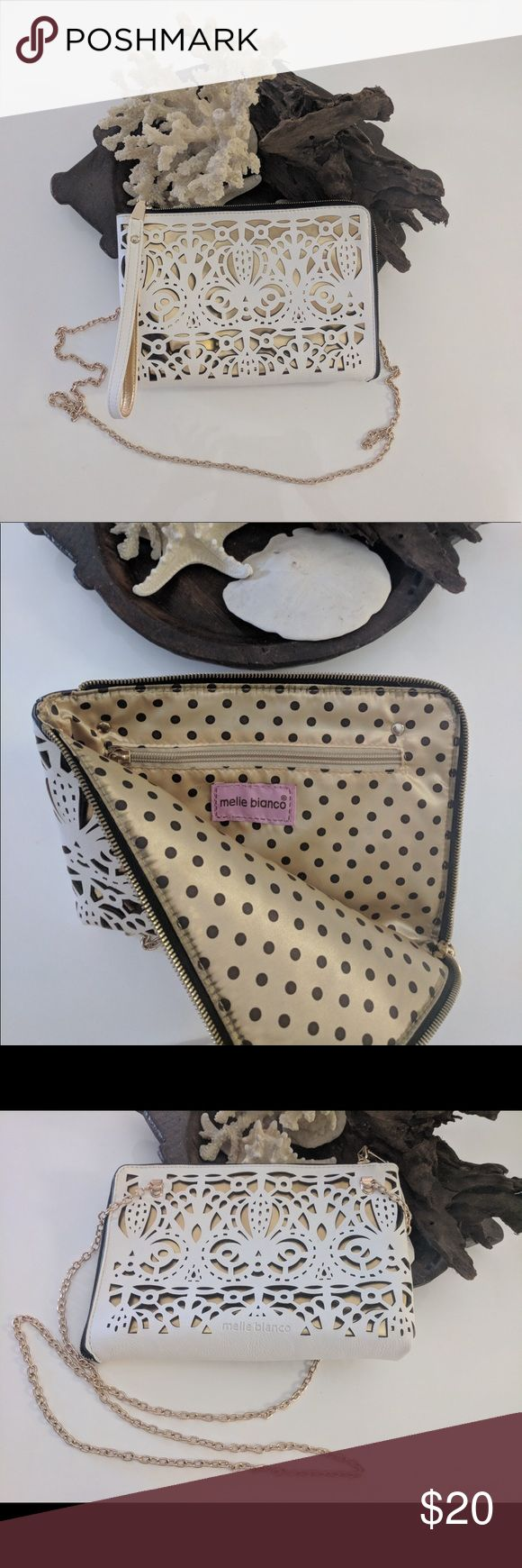 """Melie Bianco laser cut cross body/ clutch vegan Nice used condition Melie Bianco bag White with gold chain. Polyurethane laser cut white over gold. Cute polka dot lining. 9"""" wide x 1"""" deep x 6.5"""" tall. Inside zipper pocket. Melie Bianco Bags Crossbody Bags"""