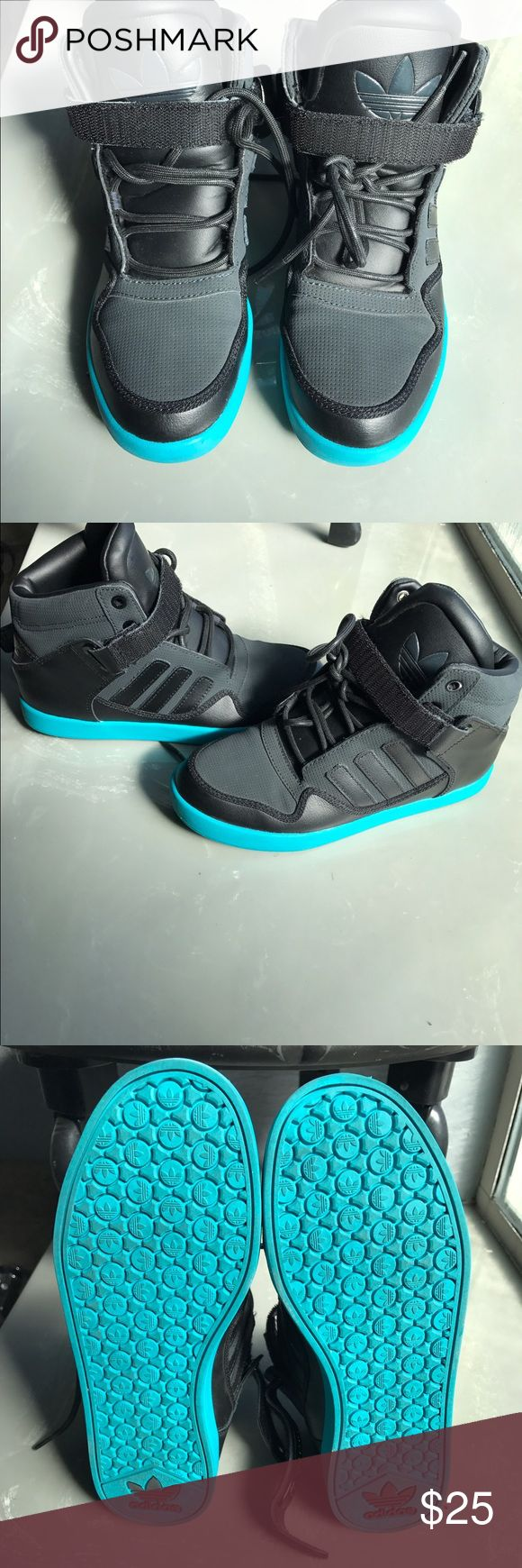 Adidas high tops Black adidas high tops with turquoise bottom. Size 4.5 in children's. I wear a size 6- 6.5 in women's normally. Worn twice. Like new. Adidas Shoes Sneakers