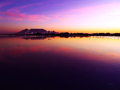 Click on image to view non sample image. Another stunning sunset of Table Mountain from Big Bay Beach in Cape Town South Africa. Really vibrant piece