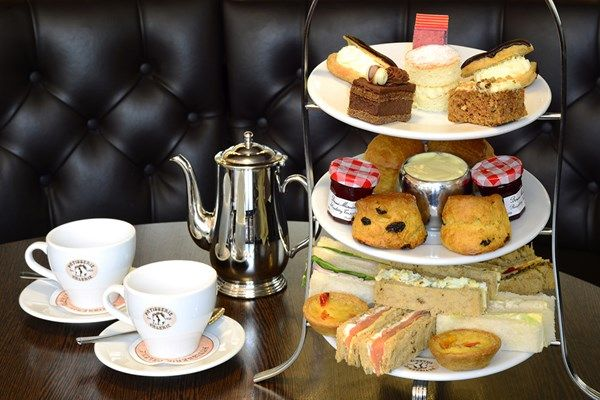 Choose your Patisserie Valerie venue and indulge in a delicious afternoon tea selection that includes handcrafted cakes and tasty sandwiches