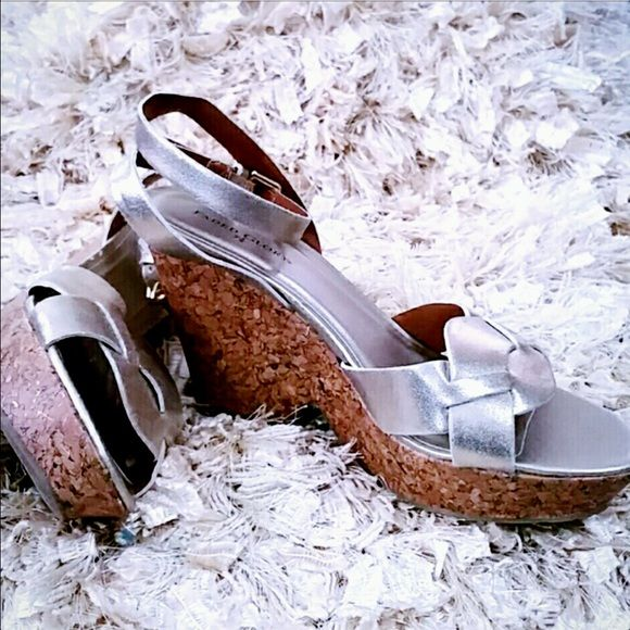 New metallic wedge heel ankle strap sandals Muted gold color sparkles in the wedge heel. Beautiful shoes defects on the inside sole as shown in fourth picture.  This will not be noticable when worn. Faded Glory Shoes Sandals