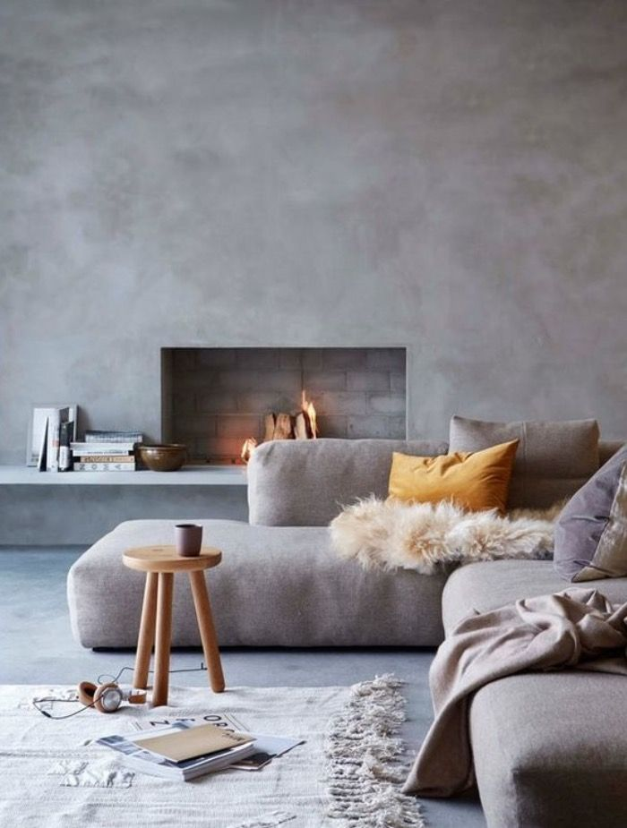 living space with open fireplace in a soft grey
