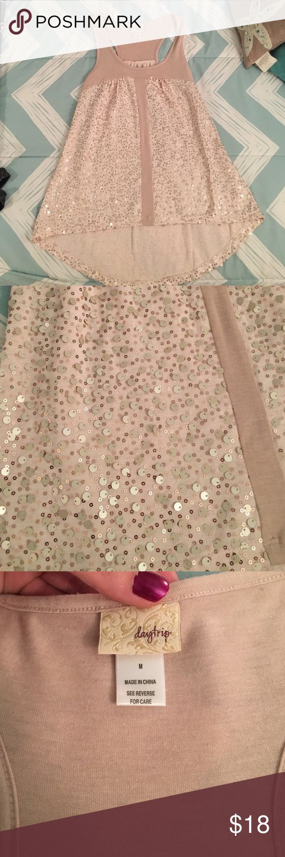 Daytrip sequin tank top  Worn twice. In wonderful condition. No flaws or defects. Cream racerback tank top with rose gold and cream sequins. Looks adorable under a cardigan. Not itchy at all Daytrip Tops Tank Tops