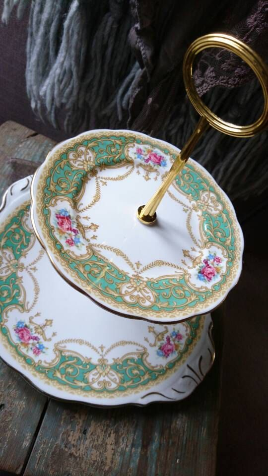 Vintage 2 tiered cake stand. Gold fixings. Green and pink