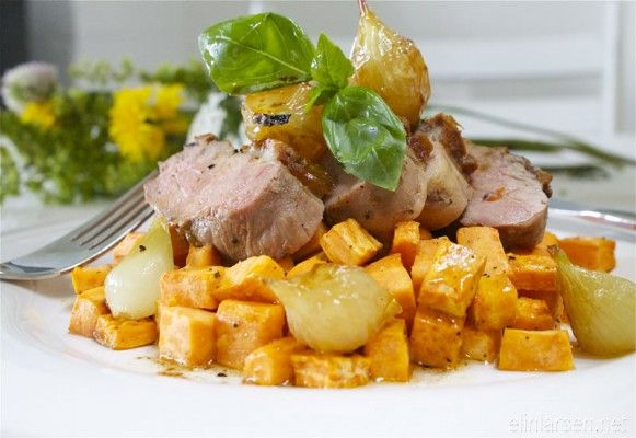 Roasted duck with baked sweet potatoes and onions