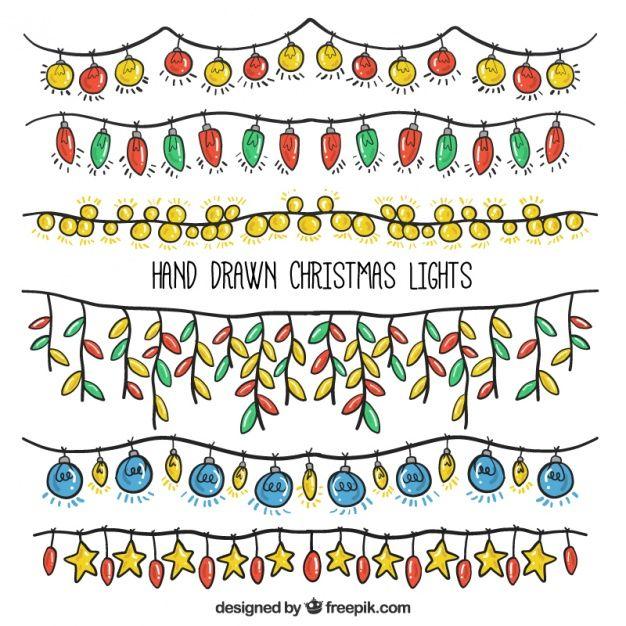 Pack of desenhado à mão luzes de natal Vetor grátis