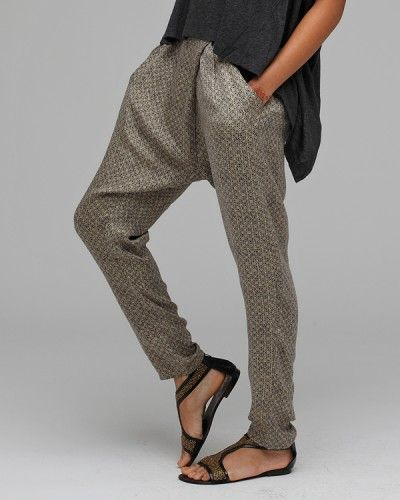 Wrap front harem pant from Funktional. Features side slant pockets, tapered leg fit, and hidden side zip. Loose fitting. 100% Silk