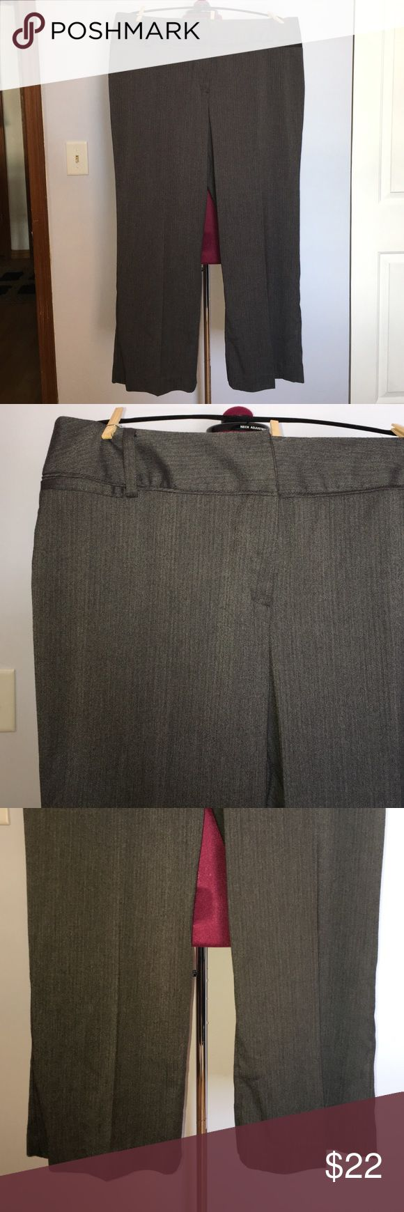 "Larry Levine Grey Herringbone Wide Leg Dress Pants Up for grabs is this pair of slacks from Larry Levine Wiman. They are a size 18W petite with a 29.5"" inseam, a 42.5"" waist and 52"" hips. These dress pants are a wide leg style and a curvy fit; curvy in the hip and thigh, a defined waistline and an hourglass silhouette. They are a dark grey herringbone with a flat panel front. These trousers have small pockets on the front hips and pockets on the rear. They are new with the original tags…"