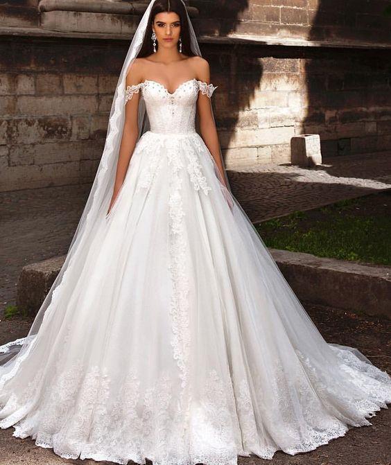 Glamorous off-the-shoulder ballgown wedding dress; Featured Dress: TM Crystal Design