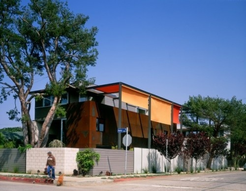Whether the shade is created by linear slats or fabric, the idea is the same, the desire to wrap and shade the house. While the linear slats of the Umbrella House create a distinct and changing pattern of shadows on the home's surfaces, fabric provides a colorful and kinetic experience.