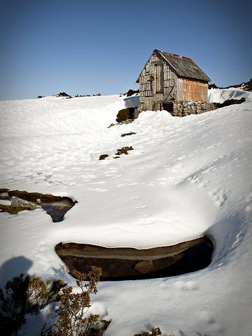 Australia. Kitchen Hut, in the shadows of Cradle Mountain in Tasmania, is used as an emergency shelter for walkers during extreme conditions. Picture: Peter Gardiner