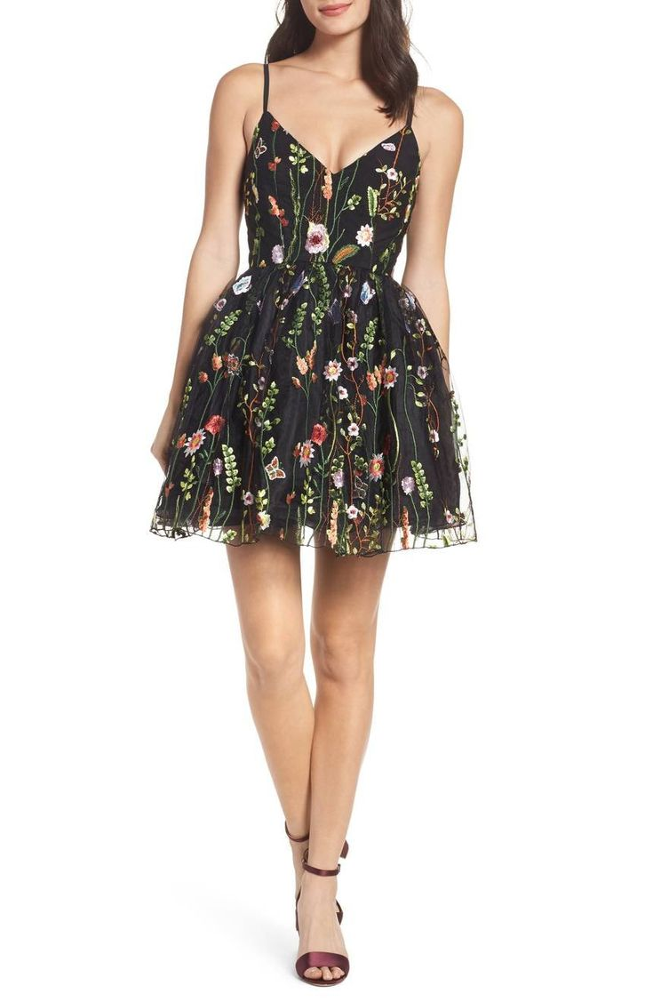 A lush garden of embroidered vines and blooms adds vibrant color and intricate texture to a short and sweet dress that's cut slim through the bodice before flaring into a floaty, puffed-up skirt.