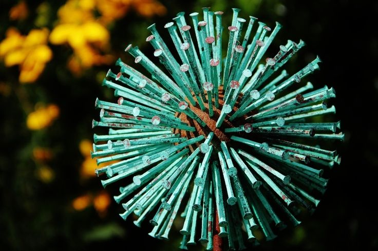 Allium Sculpture: those are nails pounded into some sort of ball. How cool is