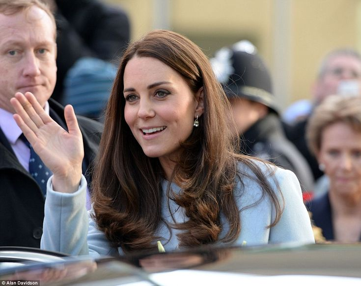 On her way: The Duchess of Cambridge is waved off as she departs for an appointment at the...