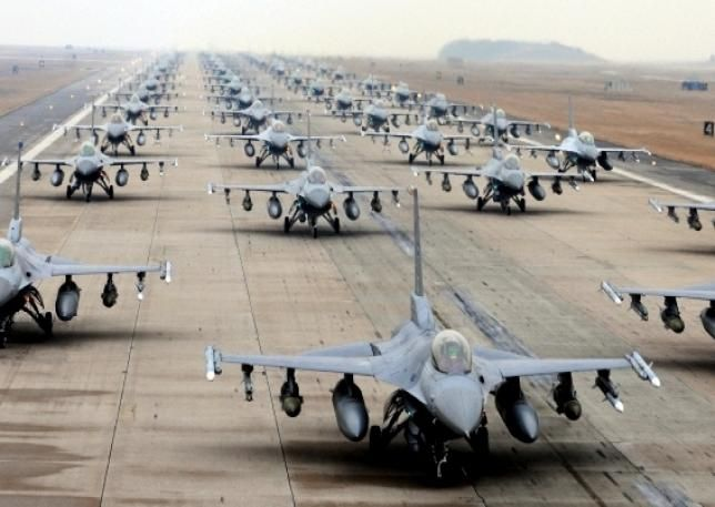 60 F-16 on same runway, awesome picture, now let's send them all at once and finish the job so we can have our soilders come home.