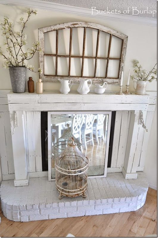 Vintage Country Farmhouse Style. Farmhouse dining room. Chippy window, ironstone pitchers, vintage ink bottles, bird cage, pear blossoms. Spring mantle. Buckets of Burlap home and blog
