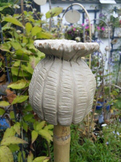 New ceramic cane topper poppy seed head.