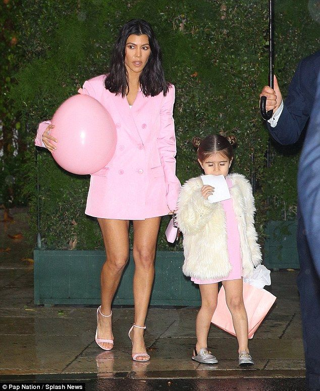 Cuties! Kourtney Kardashian took the opportunity to match with her baby girl as the pair sported millennial pink dresses for Khloe's baby shower on Saturday afternoon