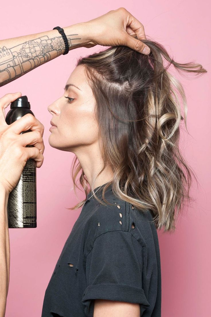 rab a can of texturizing spray or dry shampoo — Tran prefers Oribe's Dry Texture Spray — and blast the roots of your hair, holding the spray 12 inches away from your head. Go section by section, and slowly layer the spray into your locks, avoiding the ends.