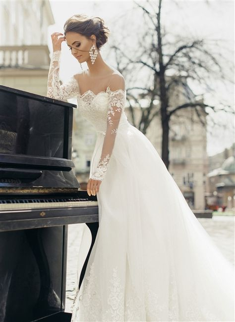 Gorgeous Illusion Lace #Wedding Dress! 2017 Alencon Lace and Tulle Over Satin A-Line Gown with an Illusion Scalloped Lace Neckline Over Sweetheart Interior, Illusion Lace Long Sleeves, Alencon Lace Over Satin Fitted and Boned Bodice to Natural Waistline Decorated with a Thin Satin Bow, Gathered Tulle Layered A-Line Skirt with a Scalloped Lace Hemline, Chapel Train, Scalloped Lace Over Satin Mid V-Back Interior with Covered Buttons. #weddingdresses #bridalgowns #offshoulderweddingdresses…