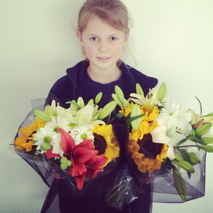 Beautiful assistant with mini petal bouquets of lilies and sunflowers! www.minipetals.com