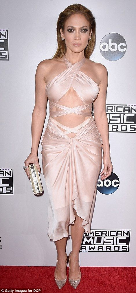 Jennifer Lopez, 45, reveals her incredibly toned stomach in daring wrap dress while Selena Gomez, 22, covers up from head to toe as the stars walk the red carpet for the American Music Awards   Daily Mail Online