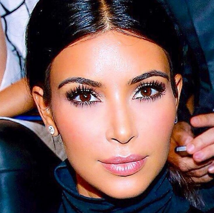 No one highlights and contours Kim Kardashian's face better than her longtime makeup artist, Mario Dedivanovic (hey, he even did her makeup at her wedding to Kanye West). And there's something he always does that I find so hypnotic and stunning on her, and you can see it clearly in this shot of the makeup he did for her in Paris this week: He puts highlighter along the edge of her Cupid's bow, that dip in her top lip. It makes her lips look not just fuller but somehow more ethereal, like ...
