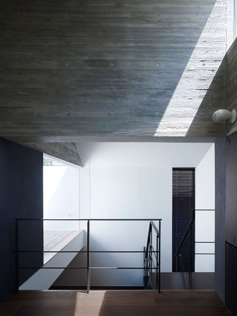 Concrete walls are left exposed inside this Japanese house