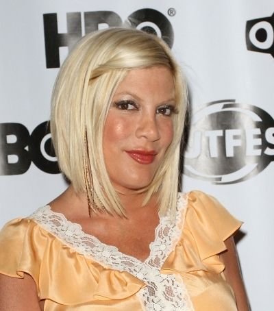 Tori Spelling Adds Subtle Feathers to her 'do