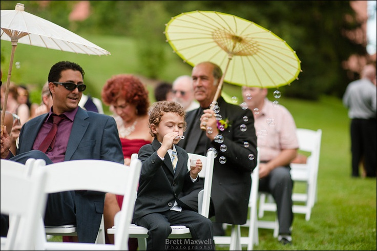 bubbles and umbrellas provided for a hot summer wedding
