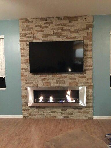 Ventless fireplace with airstone wall. All done for under $800.00