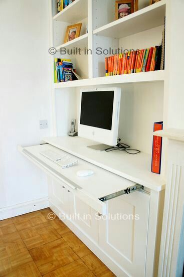 This pull-out desk would be fantastic to house the keyboard and be tucked away for the majority of the time.