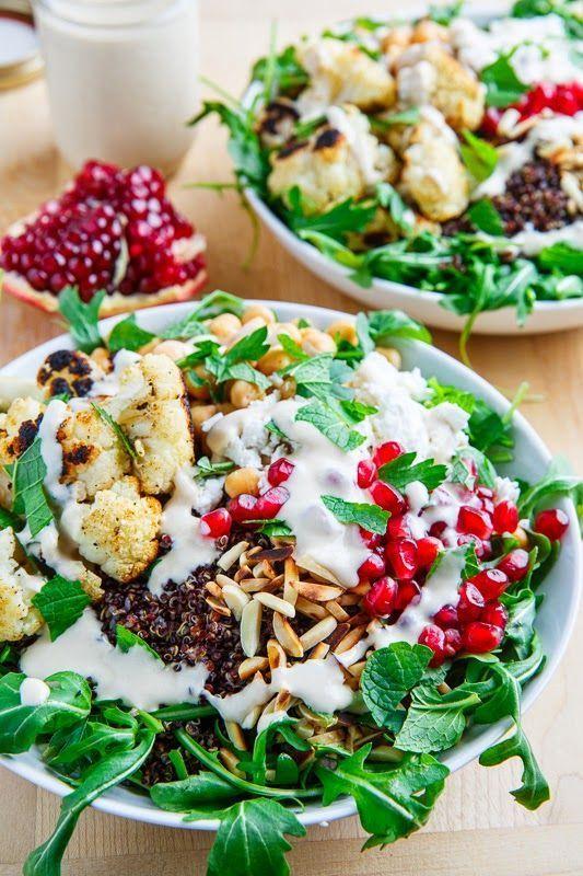Roasted Cauliflower and Chickpea Quinoa and Arugula Salad with Almonds, Pomegranate, and Feta in a Lemony Tahini Dressing #recipe #salad #healthy