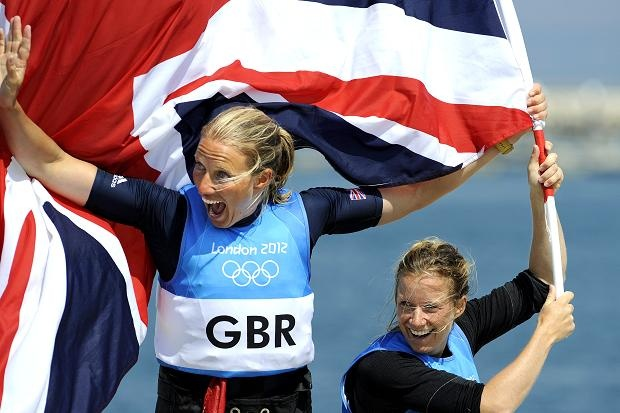 GB's Hannah Mills (right) and Saskia Clark win a sailing silver medal