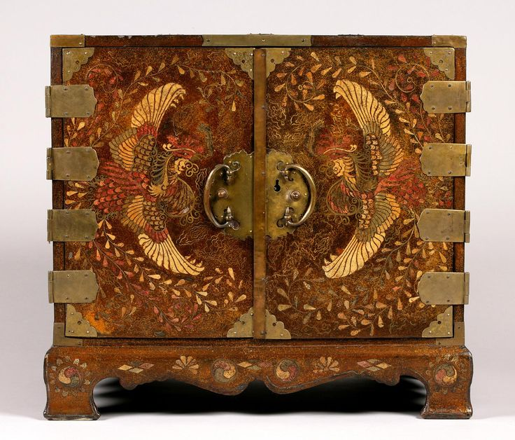Treasure Cabinet (Kap-kae-suri)  Artist/maker unknown, Korean  Geography: Made in Korea, Asia Period: Joseon Dynasty (1392-1910) Date: 19th century Medium: Lacquered wood with brass wire and dyed ray skin inlay; gilded metal fittings