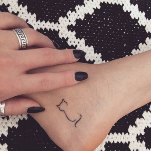 Minimalist cat tattoo on Jessenia Flemings left inner...