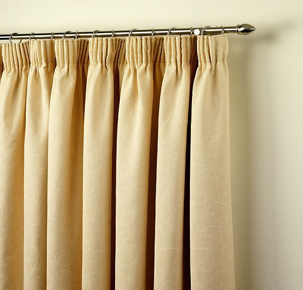 Pencil pleated curtains with rod and rings