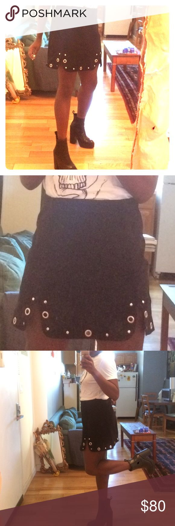 Topshop Suede Skirt w/ grommets This is a topshop skirt i got last season that unfortunately no longer fits me or i would be wearing it every day this fall! It is black suede with two little adorable cuts over each leg. It's in wonderful condition, but i must admit i have no clue how to wash it? Anyways beautiful find! my loss is your gain! Topshop Skirts Mini