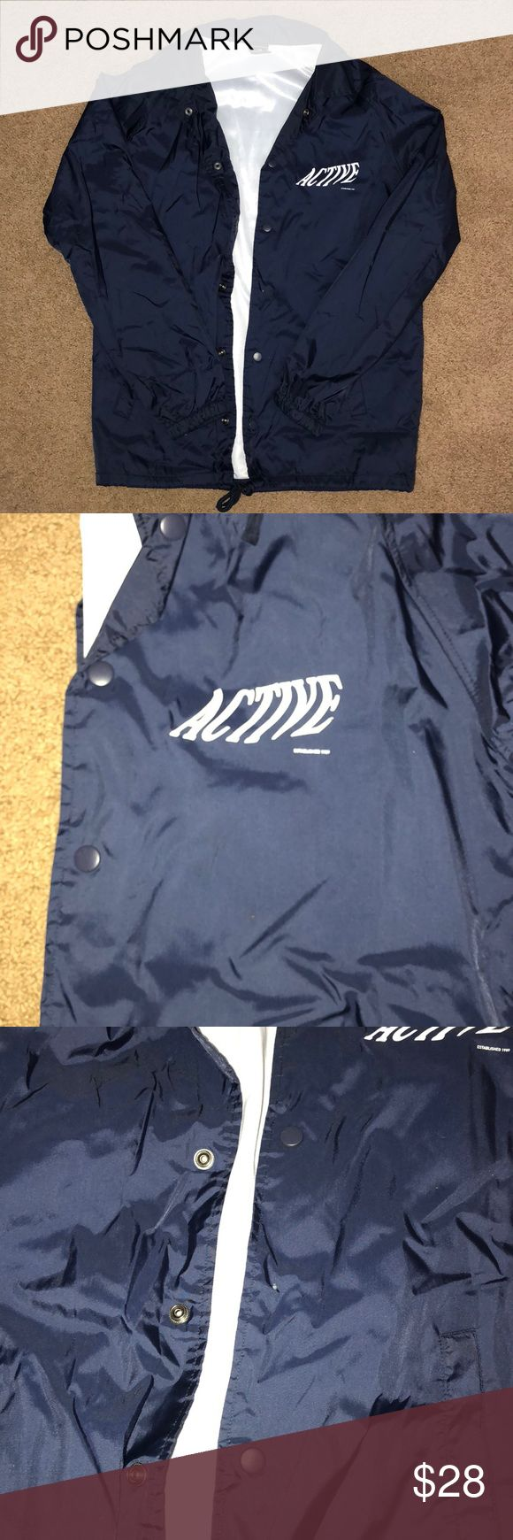 ACTIVE RIDE SHOP COACHES JACKET Windbreaker from Active Ride Shop. Brand new, Only worn about once but missing a button (as shown in picture). I received it like that from their online store, but can easily be replaced with a new button. Excellent condition other than that! Dark blue color, with collar, and two front pockets. Active Ride Shop Jackets & Coats Windbreakers