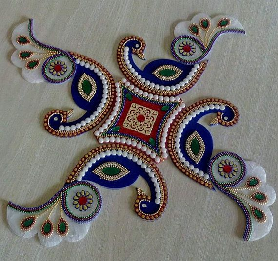 A rangoli is a colourful design made on the floor near the entrance to a house to welcome guests. At Diwali, Hindus draw bright Rangoli patterns to encourage the goddess Lakshmi to enter their homes.  -Beautiful one -of-a-kind, Peacock shaped kundan rangoli for wedding and festival décor!  -Use it as a floor art/decorative tile or simply glue it to a canvas and make your own art!  -This is a 9 piece colorful rangoli.  Each piece is made up of acrylic marble. We have used blue white and r...