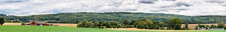 [OC] Panorama over Ryssberget Scania Sweden. Photographer John Jonasson Photo is taken from Gudahagens 800 year old Viking burial ground. Ryssberget is a 1700 million years old mountain Resolution 2000x287 Pix