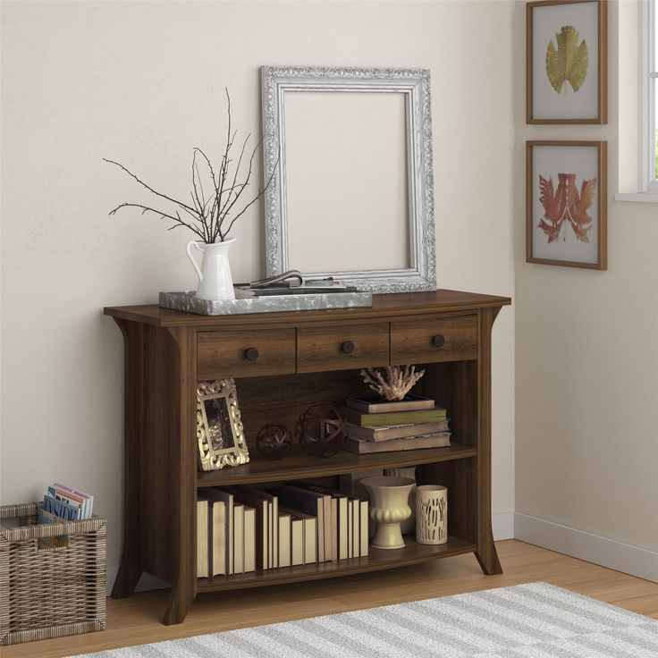 Perfect for hallways, entryways, living rooms or almost any other room in your home, this attractive Altra Oakridge Anywhere Storage Console offers storage space and style. Its 3 drawers and 2 open shelves provide plenty of room for books, magazines and all the other miscellaneous items that normally clutter your home. You can even use it as a buffet table for storing serve ware, flatware or bar items. The Anywhere Storage Console is dressed with a beautiful rustic oak finish that blends…